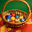 Painted Easter eggs in a basket — Stock Photo