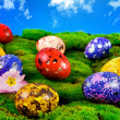Painted Easter eggs on a green meadow - Stock Photo