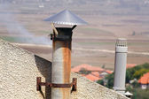 Old rusty chimney of a fireplace and roof. — Stock Photo