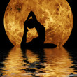 Royalty-Free Stock Photo: Yoga on moon and water background