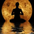 Yoga on moon and water background - Stock Photo
