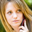 Beautiful young woman talking on phone — Stock Photo #2036653