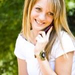 Beautiful young woman talking on phone — Stock Photo