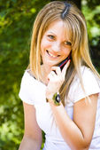 Beautiful young woman talking on phone — Stock Photo