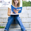 Stock Photo: Young beautiful womholding books