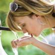 Young woman drinking water — Stock Photo