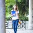 Young woman with books and flower — Stock Photo #2053667