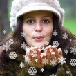 Girl blowing snowflakes — Stock Photo