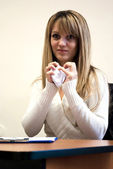 Young businesswoman showing angry face and squishing papers — Stock Photo