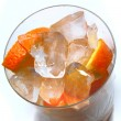 Grapefruit and orange in the ice — Stock Photo