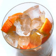 Grapefruit and orange in the ice - Stock Photo