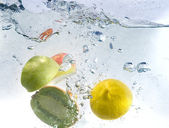 Fresh water drops on fruits isolated — Stock Photo