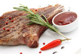 Rib-eye steak resting on a white plate — Stock Photo