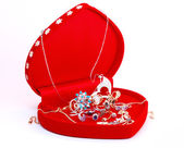 Red heart box with jewelry — Stock Photo