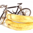 Toy bike and bananas — Stock Photo