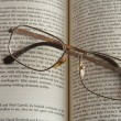 Glasses and book — Stockfoto