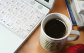 Cup of coffee and computer — Stock Photo