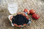 Black caviar and vodka — Stock Photo