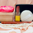 Stock Photo: Cosmetics on pink background