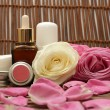 Cosmetics and roses — Stockfoto