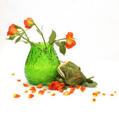 Orange roses in a green vase — Stock Photo