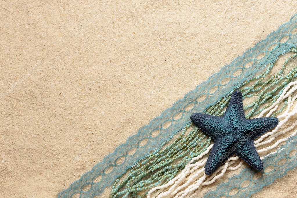 Blue starfish on the bright sea sand for cards — Stock Photo #1576643