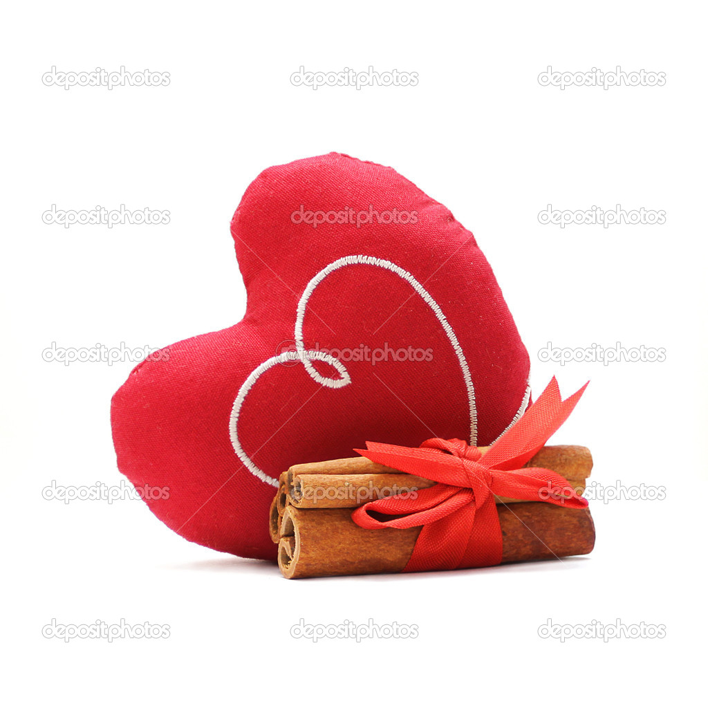 Heart, cinnamon and red ribbon on white background — Stock Photo #1576885