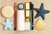 Cosmetics on the sea sand — Stock Photo