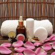 Natural cosmetics with pink rose petals — Stock Photo