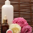 Spa products with roses — Stock Photo