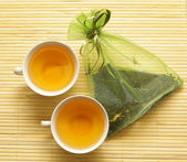 Cups and a silk bag with tea — Stock Photo