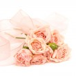 Roses and ribbons on white background — Stock Photo