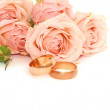 Rings and roses on white background — Stock Photo #1877927