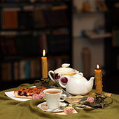 Tea against a background of candles — Stock Photo