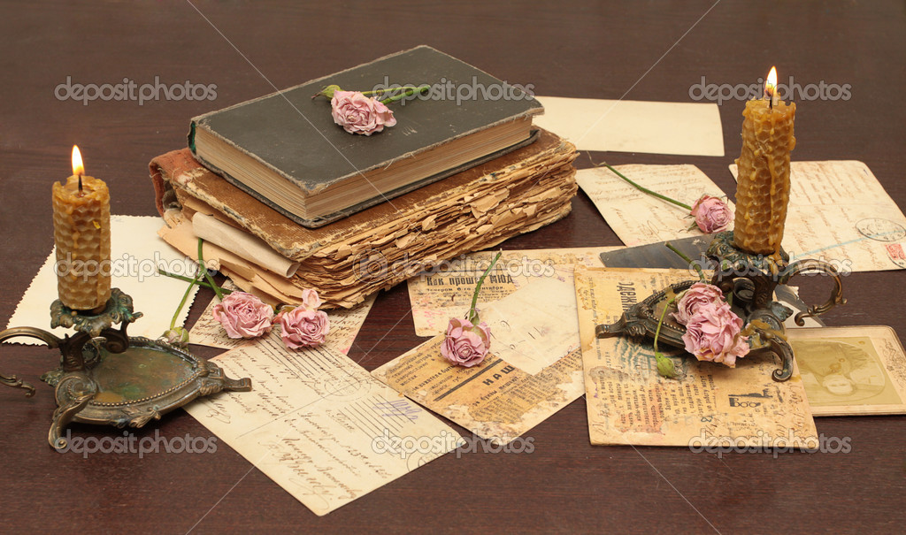 Vintage background with old books, postcards, candles and flowers — Stock Photo #1901652