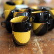 Mugs on a wooden table — Stock Photo