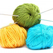 Stock Photo: Balls of wool with knitting needles