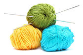 Balls of wool with knitting needles — Stock Photo