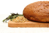 Cut bread, germinated wheat, herb — Stock Photo