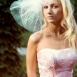 A young woman in a pink dresses — Stock Photo