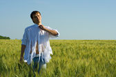 The man on wheat goes unbuttoning a butt — Stock Photo