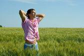 The man on wheat — Stock Photo