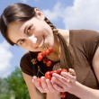 Stock Photo: Young womwith cherry