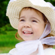 Stock Photo: The small girl in a hat on the nature