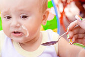The little girl is porridge — Stock Photo