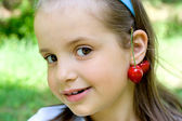 The little girl with cherry — Stock Photo
