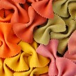 Colored farfalle pasta background — Lizenzfreies Foto