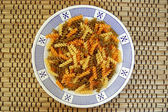 Fusilli pasta background — Stock Photo