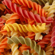 Multi colored twirls pasta background — Stock fotografie