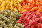 Four flavors of fusilli pasta — Stock Photo